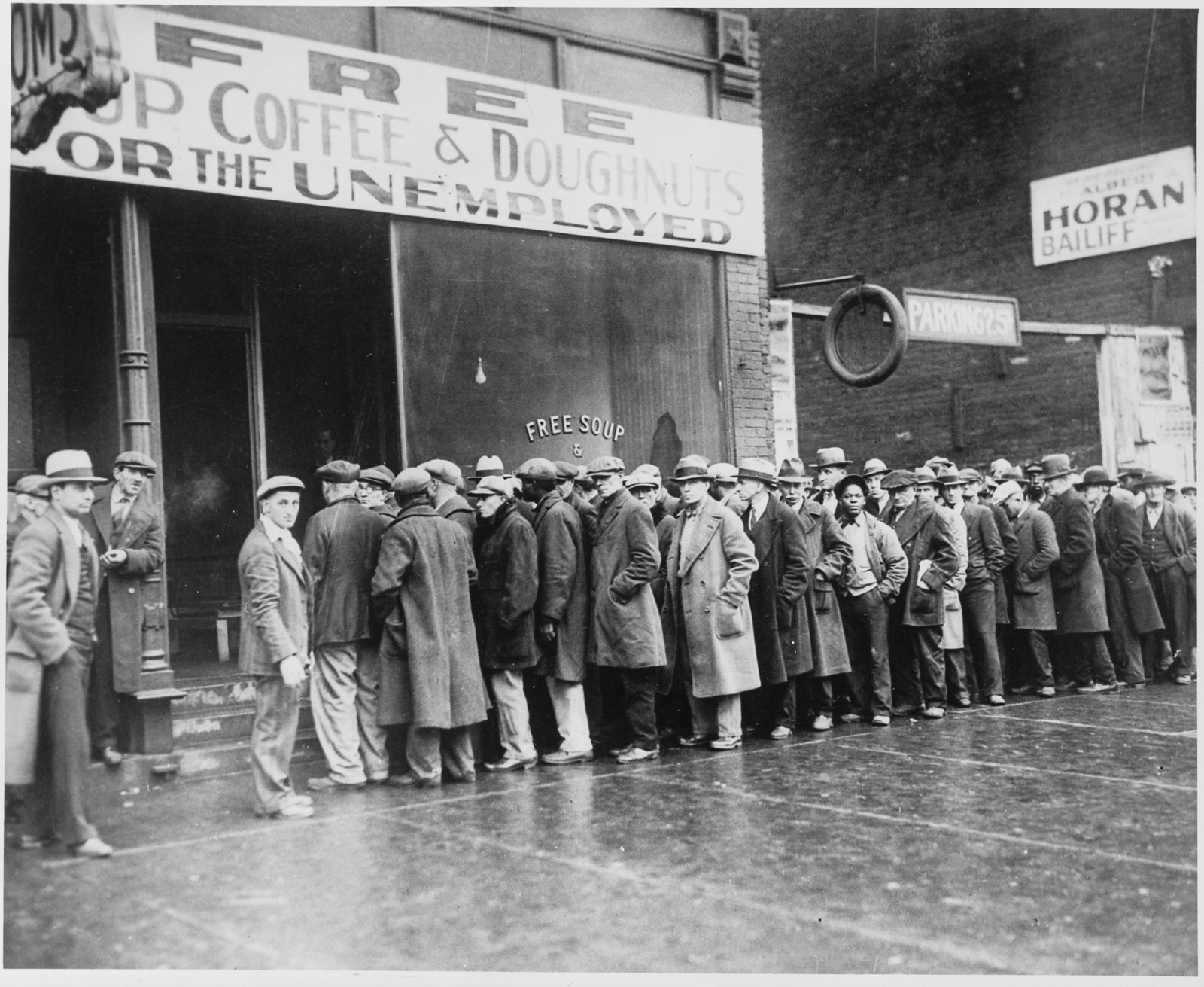 a depressed america Jack dempsey, america's first unemployed men vying for jobs at the american legion employment bureau in los angeles during the great depression.