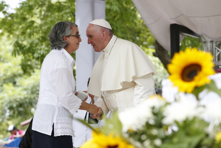 Pope Francis greets Hermana Blanca Nubia Lopez as he blesses the cornerstone of Talitha Qum homeless shelter in Cartagena, Colombia (CNS photo)
