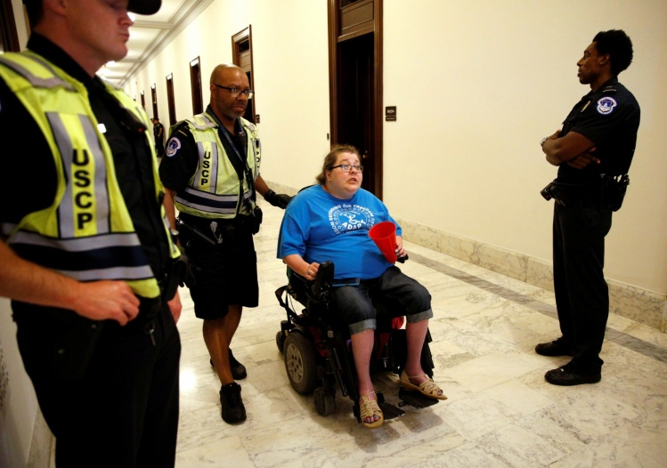 A protester demonstrating against the Senate health care bill outside Senate Majority Leader Mitch McConnell's office / CNS photo