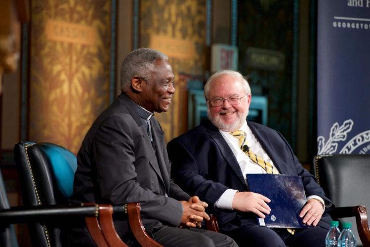 Cardinal Peter Turkson and John Carr / CNS photo