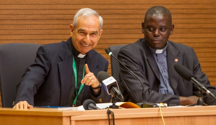 CNS photo/Robert Duncan: Jesuit Father Orlando Torres, rector of the International Gesu College in Rome, gestures during a Sept. 27 news conference in Rome to discuss the general congregation meeting, which will open Oct. 2. Father Patrick Mulemi, communications director at the Jesuit headquarters, is pictured at right.