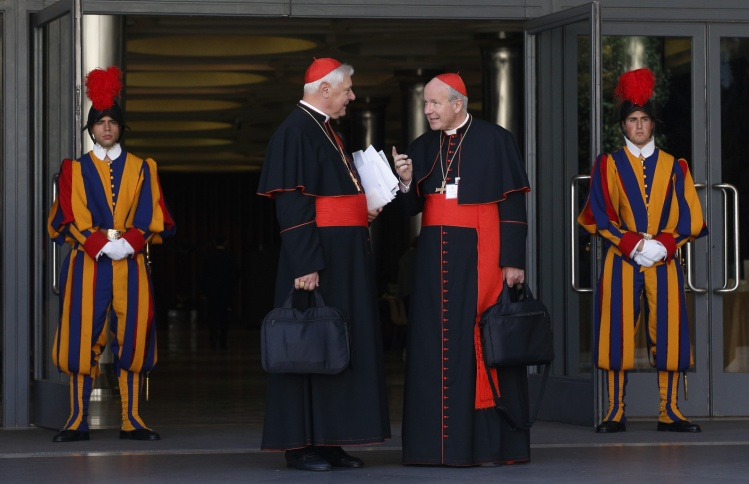 Cardinals Muller and Schonborn talk after morning synod session at Vatican