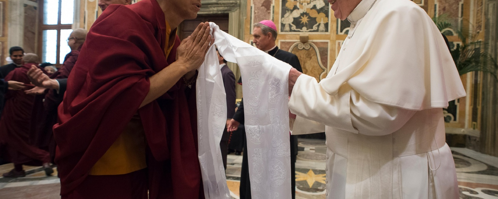 Pope Francis greets a Buddhist monk during a November audience with religious leaders at the Vatican / CNS photo