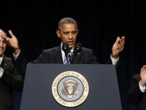 U.S. Sens. Casey and Wicker applaud as President Obama speaks at National Prayer Breakfast in Washington