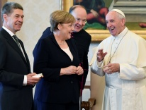Pope Francis with German Chancellor Angela Merkel and her husband during a private meeting on June 17, 2017 / CNS photo
