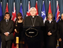 CNS/Art Babych:Cardinal Thomas Collins of Toronto speaks alongside other Canadian religious leaders
