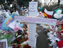 A cross bearing the first names of the victims of the 2012 shootings at Sandy Hook Elementary School / CNS photo
