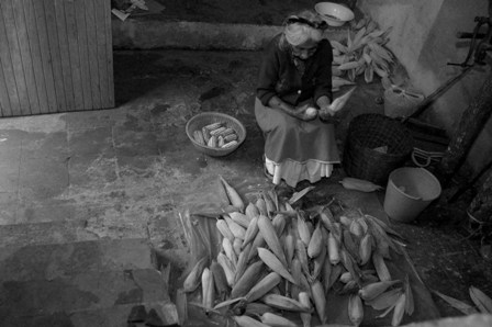 Francisca shucking corn in Cuetzalan